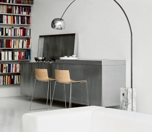 Big and bold, it's the Arco Floor Lamp with marble base, part of MoMA's permanent collection